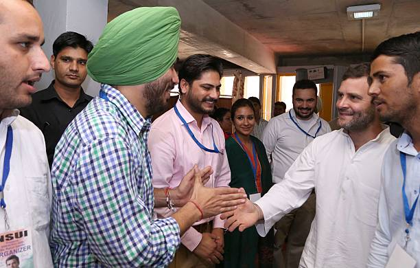 Congress leader Rahul Gandhi meets with NSUI national team member Brinder Singh Dhillon at Punjab University Campus on October 16 2014 in Chandigarh..