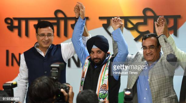 Congress Leader Randeep Surjewala Former BJP Leader Arvinder Singh Lovely Congress Leader Ajay Maken and others during a press conference after...