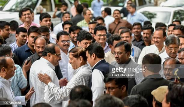 Congress leader Sharad Ranpise Radhakrishna Vikhe Patil NCP leader Ajit Pawar Dhananjay Munde Girish Bapat Maharashtra Chief Minister Devendra...