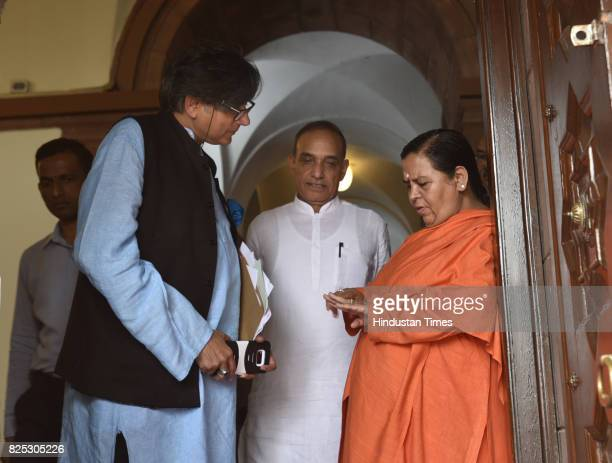 Congress leader Shashi Tharoor and BJP leader Uma Bharti during the monsoon session of the Parliament at Parliament Library on August 1 2017 in New...