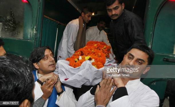 Congress leader Shashi Tharoor and relatives and friends carry the body of Tharoor's wife Sunanda Pushkar before her cremation at Lodhi Road...