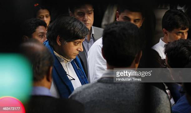 Congress leader Shashi Tharoor gestures to media while escorting the body of his wife Sunanda Pushkar at Lodhi Road crematorium South Delhi on...