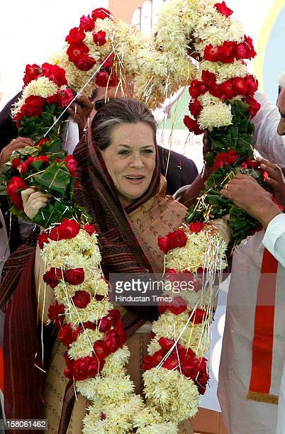 Congress leader Sonia Gandhi being greeted during an election campaign on December 10 2012 in Siddhpur India Polls in Gujarat will take place in two...