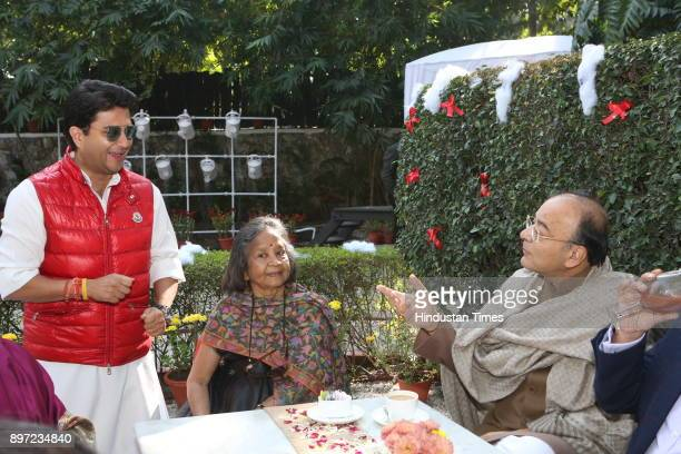 Congress leaderJyotiraditya Scindia talking with Finance Minister Arun Jaitley during Christmas Brunch party hosted by Dilip and Devi Cherian on...