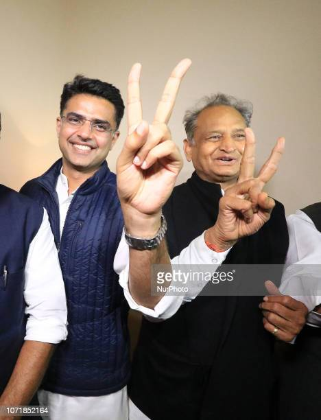 Congress leaders Ashok Gehlot and Sachin Pilot flash victory signs after the declaration of Rajasthan Assembly election result, in...