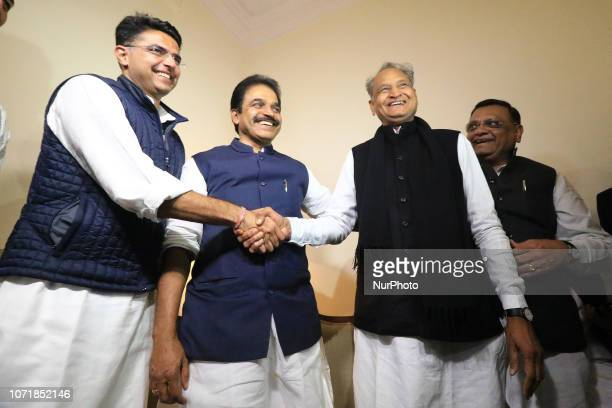 Congress leaders Ashok Gehlot and Sachin Pilot shake hands as AICC general secretary KC Venugopal looks on after the declaration of Rajasthan...
