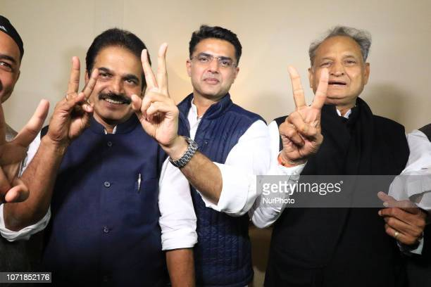 Congress leaders Ashok Gehlot , Sachin Pilot , K.C. Venugopal flash victory signs after the declaration of Rajasthan Assembly election result in...