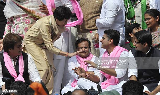 Congress leaders Ghulam Nabi Azad Ambika Soni Raj Babbar Ahmed Patel Selja Kumari and Sachin Pilot shared the stage during their protest against the...