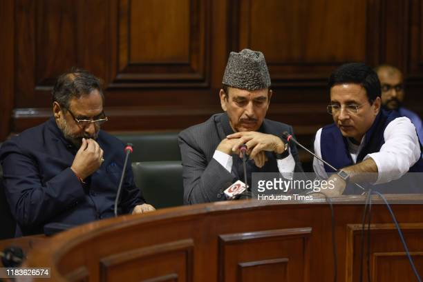 Congress leaders Ghulam Nabi Azad Anand Sharma and Randeep Surjewala address a press conference after attending the winter session of Parliament on...