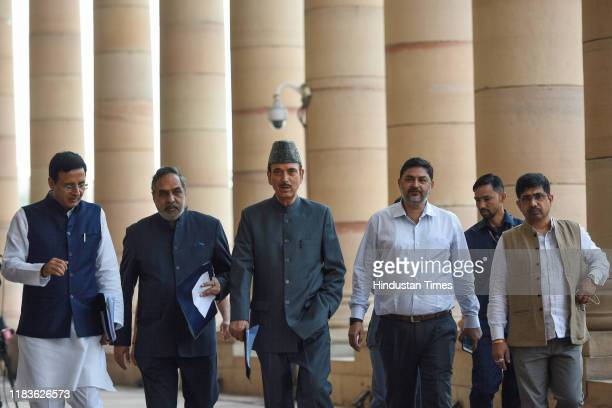 Congress leaders Ghulam Nabi Azad Anand Sharma Randeep Surjewala and others arrive to address a press conference during the winter session of...