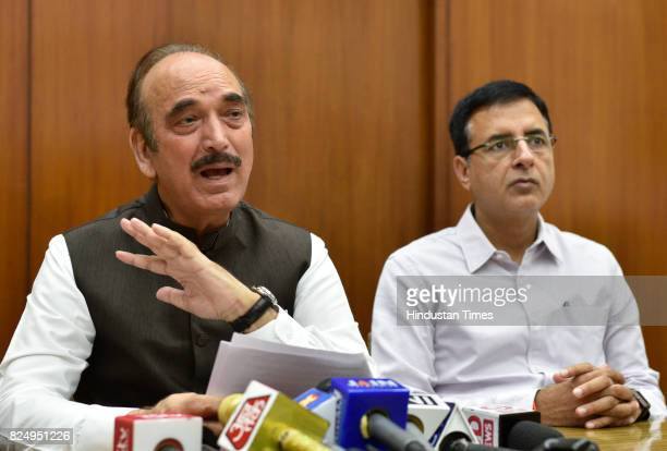 Congress leaders Ghulam Nabi Azad and Randeep Singh Surjewala address a press conference on flood situation at Parliament House on July 31 2017 in...