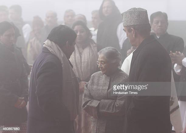 Congress leaders Ghulam Nabi Azad with Sheila Dikshit during Congress Partys 130th foundation day at AICC Headquarters during heavy fog on December...