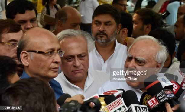 Congress leaders Jairam Ramesh Kapil Sibal Abhishek Singhvi and Vivek Tankha talk to media after meeting Chief Election Commissioner Om Prakash Rawat...