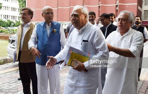 Congress leaders Jairam Ramesh Kapil Sibal Abhishek Singhvi and Vivek Tankha after meeting Chief Election Commissioner Om Prakash Rawat at Nirvachan...