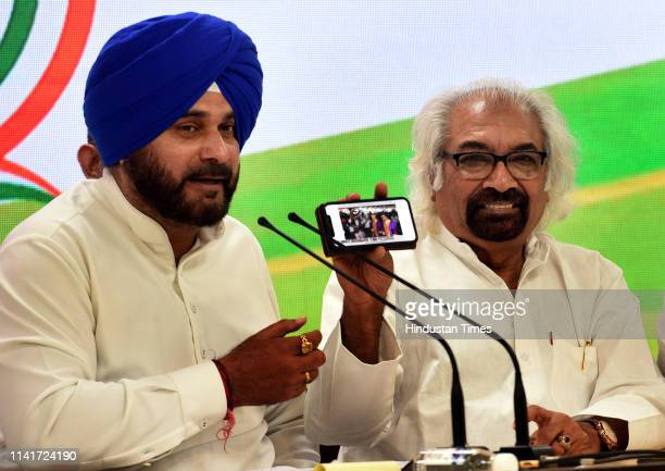 Congress leaders Navjot Singh Sidhu and Sam Pitroda during a press conference attacked Prime Minister Narendra Modi saying he had come to power in...