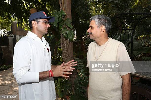 Congress leaders Sachin Pilot and Sandeep Dikshit during the preChristmas Party thrown by Dilip and Devi Cherian on December 14 2013 in New Delhi...