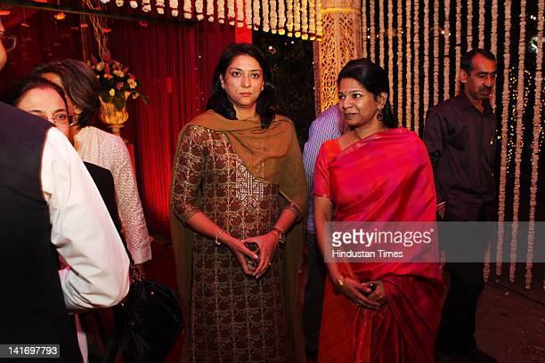 Congress Lok Sabha MP Priya Dutt with DMK Rajya Sabha MP Kanimozhi attending Hamdullah SayeedAamna Mirza's wedding reception held on on March 15 2012...