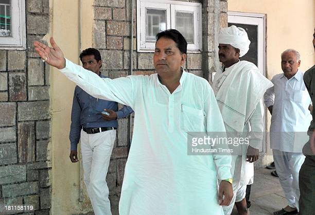Congress MLA and Minister of State for Dairy and Khadi Babulal Nagar before informing media persons about his resignation on September 19 2013 in...