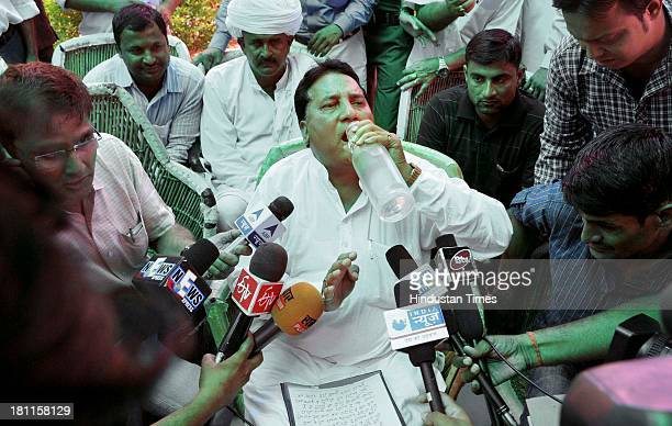 Congress MLA and Minister of State for Dairy and Khadi Babulal Nagar gulps water before informing media persons about his resignation on September 19...