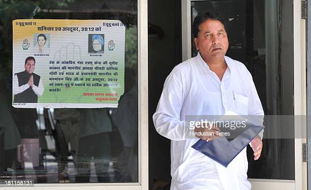 Congress MLA and Minister of State for Dairy and Khadi Babulal Nagar comes out of his room with copies of his resignation on September 19 2013 in...