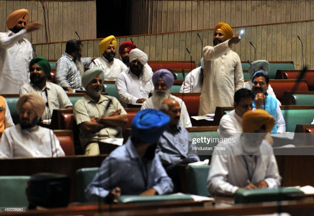 Congress MLA mocking SADBJP government on issue of power cuts by putting their mobile lights on in the assembly during power breakdown at Punjab...