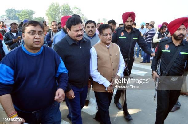 Congress MLA Raj Kumar Verka Congress district President Jugal Kishore Sharma arrive to meet relatives of victims after two men on a motorcycle...