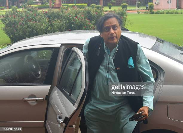 Congress MP Shashi Tharoor arrives to attend third day of the Monsoon Session of Parliament on July 20 2018 in New Delhi India A debate is under way...