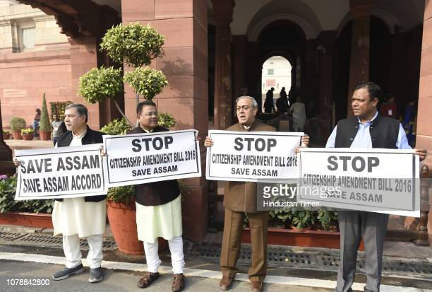 Congress MPs hold placards during a protest demanding to stop citizenship amendment bill 2016, during the Winter Session of Parliament, on January 7,...