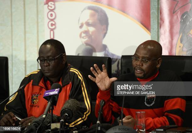 Congress of South African Trade Unions president Sdumo Dlamini flanked by COSATU general secretary Zwelinzima Vavi gives a press conference on May 29...