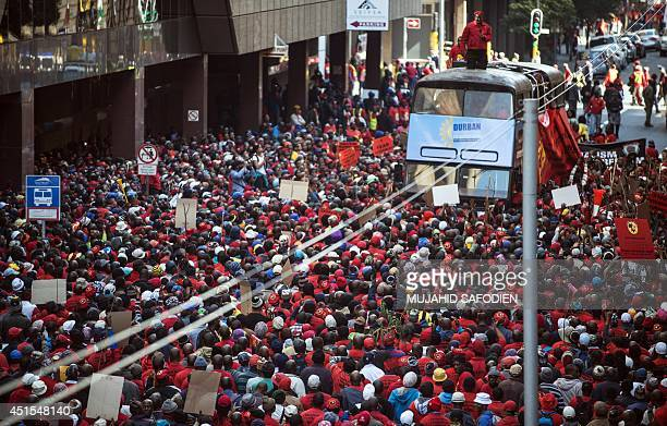 Congress of South African Trade Unions Secretary General Zwelinzima Vavi stands on a bus as he adresses the crowd on the first day of a nationwide...