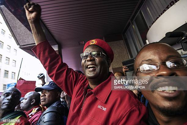 Congress of South African Trade Unions Secretary General Zwelinzima Vavi raises his fist as he arrives to address striking members South Africa's...