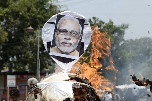 TOPSHOT Congress party activists burn an effigy of Indian Prime Minister Narendra Modi during protest against the fuel price hike in Jalandhar in...