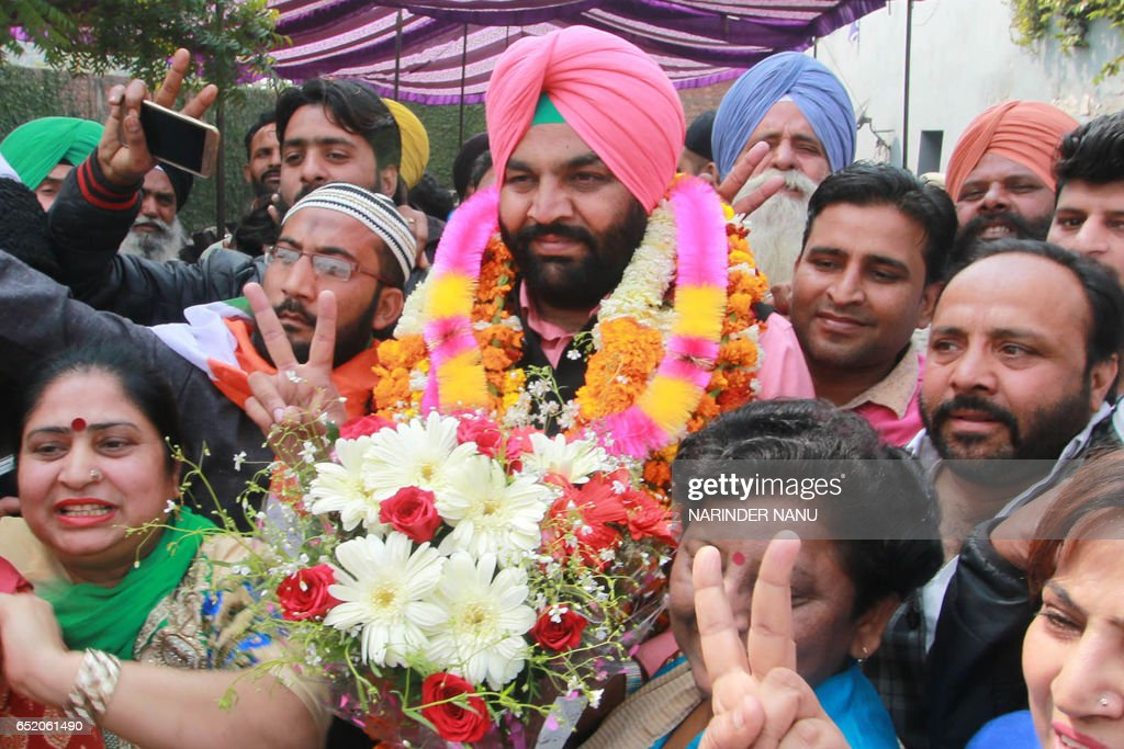 Congress Party candidate for Amritsar Lok Sabha and DCC rural president Gurjeet Singh Aujla flashes the victory sign after the announcement of...