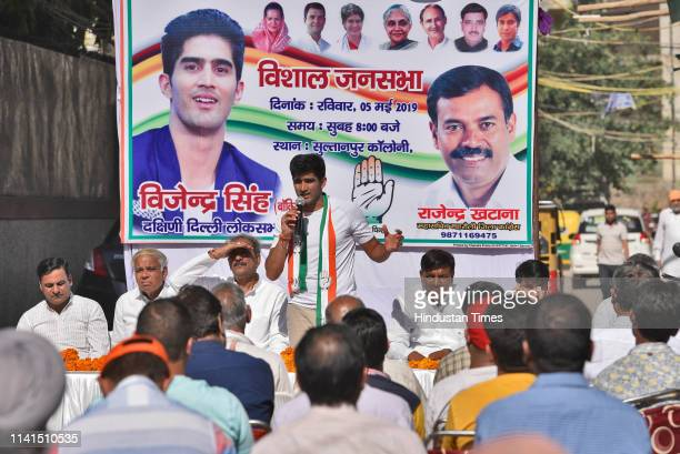Congress party candidate from the South Delhi Lok Sabha constituency Vijender Singh addresses a gathering as part of his ongoing election campaign at...