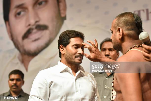 Congress Party Chief Jaganmohan Reddy is being blessed ritually by priests after arriving at the Andhra Bhawan on May 26 2019 in New Delhi India...