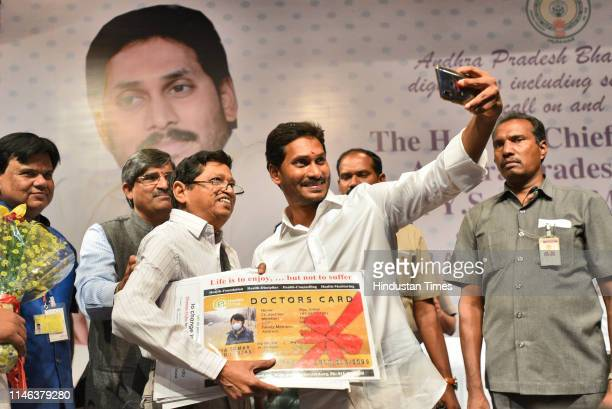 Congress Party Chief Jaganmohan Reddy takes a selfie with his supporter after arriving at the Andhra Bhawan on May 26 2019 in New Delhi India Reddy...