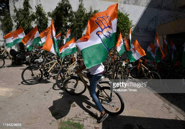 Congress party flags tied to cycles during party's cycle campaign rally for upcoming Lok Sabha elections at Madipur on April 1 2019 in New Delhi India