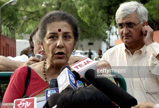 Congress party General Secretary Ambika Soni speaks to the press as Senior Congress leader Salman Khurshid looks on after a meeting with Congress...