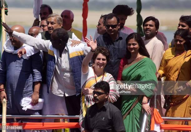Congress party General Secretary and eastern Uttar Pradesh state in-charge Priyanka Gandhi Vadra waves towards supporters of varanasi during the last...