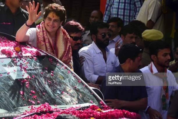 Congress party General Secretary and eastern Uttar Pradesh state incharge Priyanka Gandhi Vadra waves towards local supporters and people of varanasi...