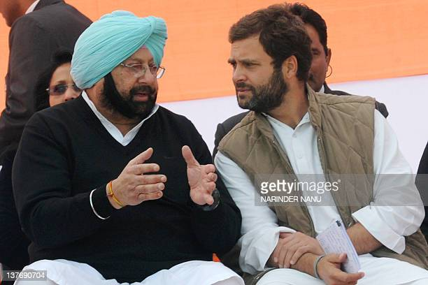 Congress Party General Secretary Rahul Gandhi talks to former Chief Minister of Punjab Amarinder Singh during a Congress election campaign rally in...