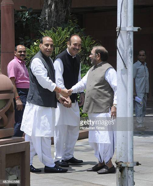 Congress Party leader Ghulam Nabi Azad BJP leader and Union Home Minister Rajnath Singh and JD leader Sharad Yadav as they arrive to attend All Party...