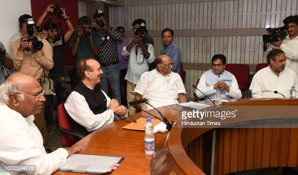 Leader Sharad Pawar with Congress party leader Mallikarjun Kharge after a meeting with opposition party leaders called by Congress party ahead of the...