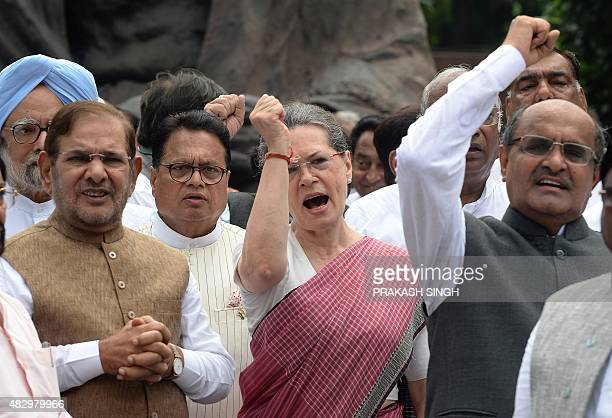 Congress Party President Sonia Gandhi joins other Congress Party members of parliament to shout slogans against Prime Minister Narendra Modi and the...