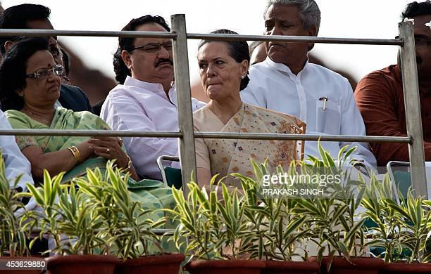 Congress Party President Sonia Gandhi listens to a speech by India's Prime Minister Narendra Modi at the Red Fort to mark the country's 68th...