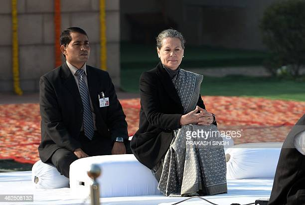 Congress Party President Sonia Gandhi pays homage at Rajghat the memorial of India's founding father Mahatma Gandhi on Martyrs' Day in New Delhi on...
