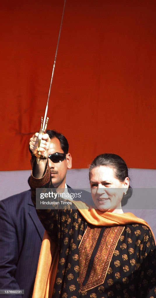 Congress Party President Sonia Gandhi waves a sword during an election rally on January 24, 2012 in Gurdaspur, India. Addressing the rally, Congress Party President lashed out at incumbent SAD-BJP government in Punjab for not utilizing central funds for development of state and pushing Punjab into backwardness.