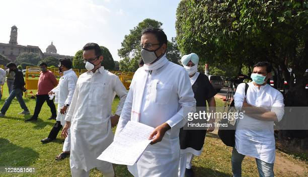 Congress party spokesperson Randeep Singh Surjewala along with other party members arrive to brief the media on the issue of agriculture reform bill...