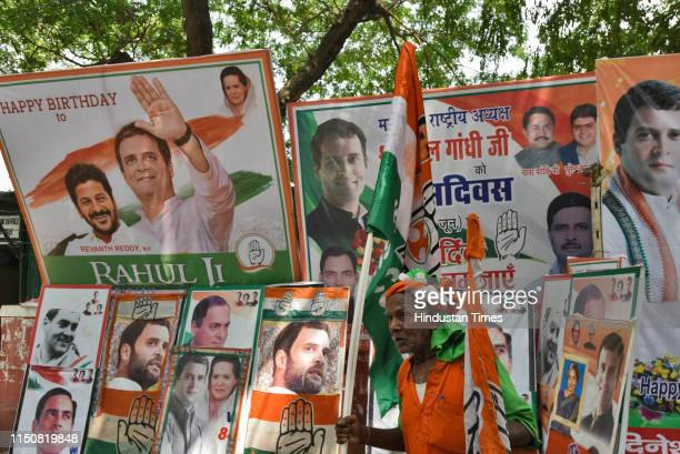Congress party supporter holds the party flag during Indian National Congress President Rahul Gandhi's 49th birthday, outside party headquarters, on...
