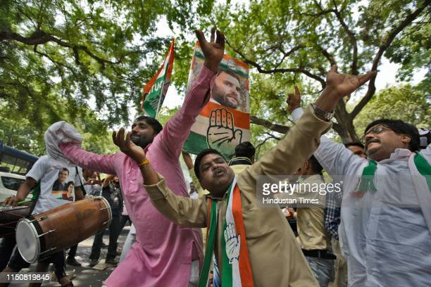 Congress party supporters dance as they celebrate Indian National Congress President Rahul Gandhi's 49th birthday, outside party headquarters, on...